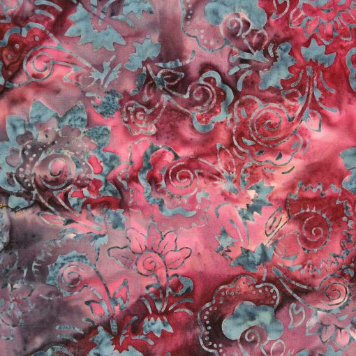 Rich brown batik fabric with a leaf pattern.