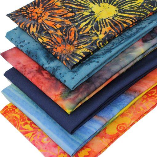 Batik fabrics in orange and blue.