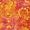 Orange and yellow batik with a floral design.